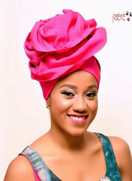 pink latest gele style beautiful smile